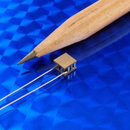 image of mini micro peltier TEC module 00701-9A30-12RU4 shown next to pencil tip for scale