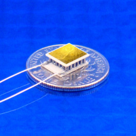 image of mini micro peltier TEC cooler module 01801-9A30-12CN shown sitting on USA Dime 10 cent coin for scale