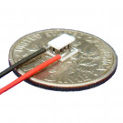 image of mini micro peltier TEC cooler module 00411-9J30-20CN shown sitting on USA Dime 10 cent coin for scale