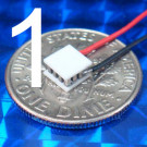 image of mini micro peltier TEC cooler module 00711-5N30-08CU4 shown sitting on USA Dime 10 cent coin for scale